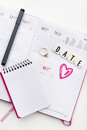 Notebook and calendar on desk